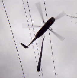 Tel-Power Using Helicopter to Set Poles